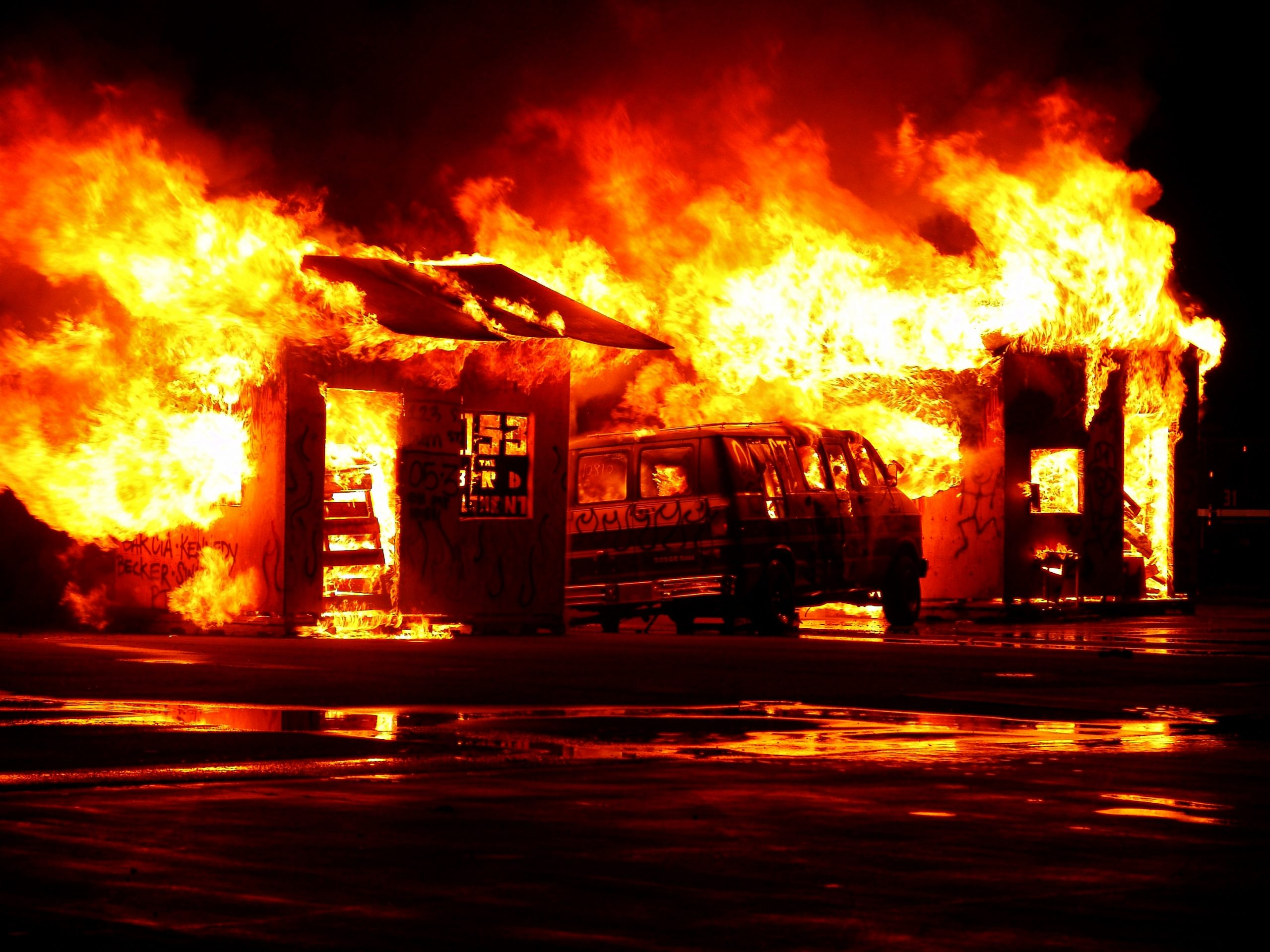 Image of care and building burning for the blog about keeping going when you are going through hell